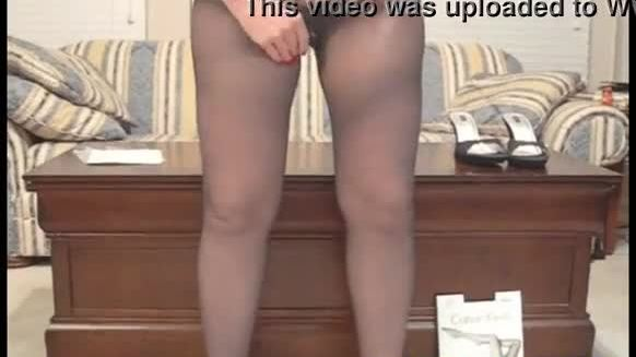 FJF Daisy models her feet and legs in a pair of black pantyhose